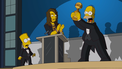 Homer accepts the award.png